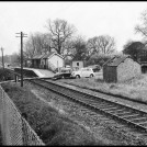 Hill End Halt, on the eastern outskirts of St Albans, formed an entrance to the mental hospital. Here, in the late 1950s, it is used as a car park and the buildings have been burnt out. | Lost Rails Project